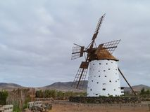 A corn wind mill on Fuerteventura. Historic wind mill in the surroundings of El Cotillo on the Spanish island Fuerteventura one of the Canary islands in the Stock Photo