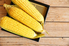 Corn on wood. Corn on barn wood background Stock Photo