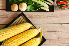 Corn on wood Stock Photos