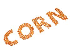Corn word made out from corn seeds. Stock Photos