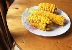 Corn. Yellow ears of corn on the wooden table Stock Photography