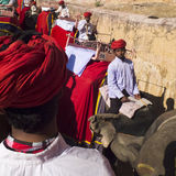Cornacs wearing red rurbans. AMBER FORT,  INDIA - MARCH 6:  several cornacs , wearing red turbans, are leading their elephants on the road to go to the castle Royalty Free Stock Image