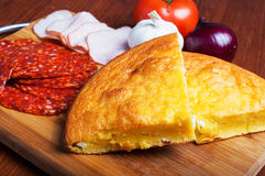 Cornbread with cheese, vegetables and meat Royalty Free Stock Image