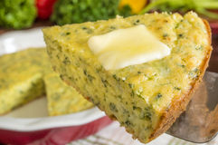 Cornbread. Freshly baked spinich cornbread with butter melting on top stock photography