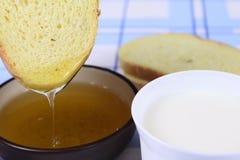 Cornbread with honey on blue napkin Stock Photo