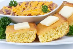 Cornbread and Red Chili Meal. On White Dinnerware Stock Photo