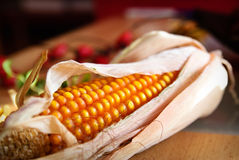 Corncob with berries Royalty Free Stock Photography