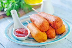 Corndogs. On the blue plate stock images