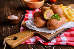 Corndogs with fries, ketchup and mustard Stock Photos