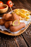 Corndogs with fries, ketchup and mustard Royalty Free Stock Images