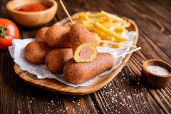 Corndogs with fries, ketchup and mustard Stock Photography