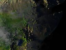 Corne de l'Afrique sur terre la nuit - fond océanique évident Images stock