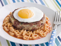 Corned Beef Hash Cake with Alphabet Pasta Royalty Free Stock Images