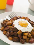 Corned Beef Hash With a Fried Egg and Black Pepper Royalty Free Stock Image
