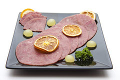 Corned beef with lemon Royalty Free Stock Images