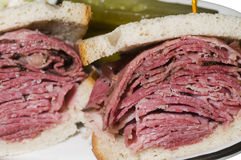 Corned beef pastrami combination sandwich. Corned beef and pastrami combination sandwich on jewish rye bread at new york delicatessen kosher restaurant Royalty Free Stock Image