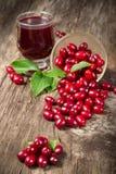 Cornel berry and juice Stock Photos