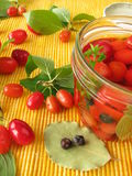 Cornelian cherries in vinegar marinade Stock Photography