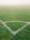 Corner arc of football pitch in the fog Stock Images