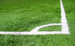 Corner area chalk line on artificial turf soccer or football field Stock Photography
