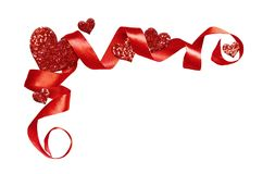 Corner arrangement with red silk twisted ribbon and glitter hear Stock Images