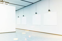 Corner of art gallery with large white wall and pictures, toned Stock Images