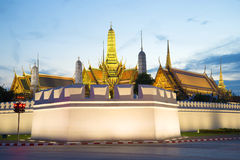 Corner Bastion and the spires of the Royal Palace in the evening twilight. Bangkok, Thailand Royalty Free Stock Image