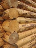 Corner baths of round logs Stock Photos