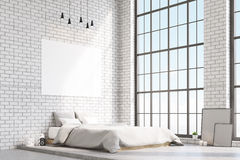 Corner of bedroom with white walls. Corner of a bedroom with white walls, a horizontal poster hanging above a bed large windows. 3d rendering. Mock up Royalty Free Stock Photography