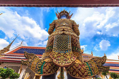 Corner, behind giant Ravana. A giant statue of Ravana Temple of the Emerald Buddha in Thailand stock images
