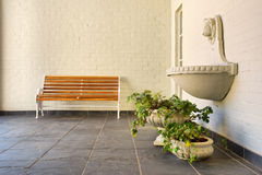 Corner with bench, fountain and vases Royalty Free Stock Photos