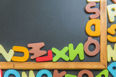 Corner of black board with colorful alphabet Royalty Free Stock Photo