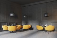 Corner of a black restaurant. Corner of a black cafe corner with a concrete floor, round black tables and yellow chairs. 3d rendering mock up Stock Images