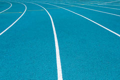 Corner of blue running track Royalty Free Stock Photo
