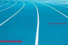 Corner of blue running track Stock Image