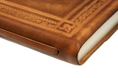 Corner of book in leather Stock Photos