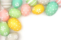 Corner border of hand painted Easter eggs over white Royalty Free Stock Photography