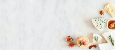 Free Corner Border With A Selection Of Cheeses, Figs, Nuts And Honey On A White Marble Background With Copy Space Stock Images - 160771514