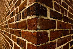 Corner of a Brick Wall. Downtown royalty free stock image
