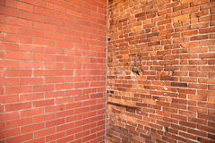 Corner in brick wall. Two different brick wall textures converging in the corner Stock Images