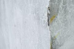 Corner of a broken gray cement wall, broken texture of the cement wall of the interior of a house royalty free stock photo