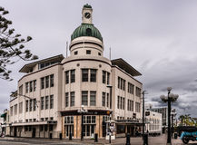 Corner building with clock tower in Napier, New Zealand. Royalty Free Stock Photos