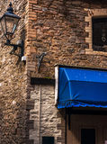 Corner of the building with an old lamp at the narrow passage be Royalty Free Stock Image