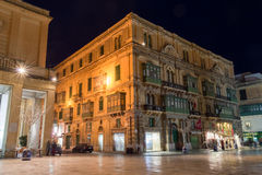 Corner building on Republic Street Valletta Malta by night Royalty Free Stock Photography