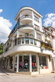 Corner building with a shop in the center of Karlovo in Bulgaria Royalty Free Stock Images