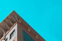 Corner of a building with windows, bottom view royalty free stock photos