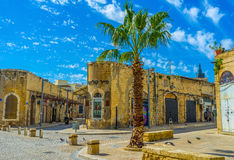 The corner buildings in old Jaffa. TEL AVIV, ISRAEL - February 25, 2016: The old stone buildings of former warehouses nowadays serve as shops and art galleries Stock Photography