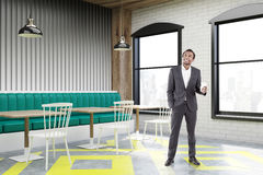 Corner of cafe with posters, gray, man Royalty Free Stock Images