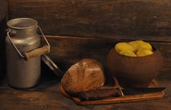 Retro, vintage food. In the corner is a can of beer next to him lying bread rye potatoes and a knife Royalty Free Stock Photos