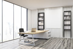 Corner of a CEO office with gray walls Stock Photo